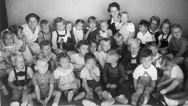 numerous children with two teachers